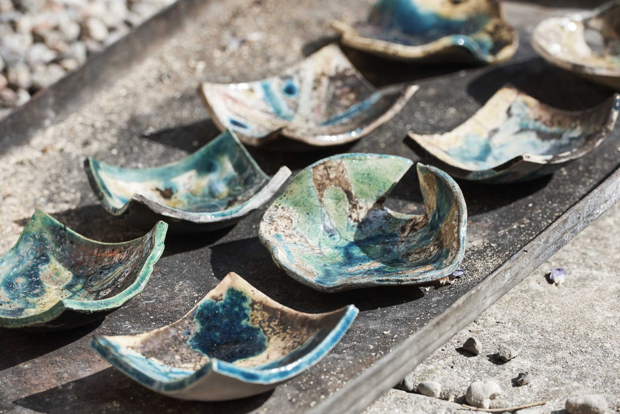 Decorated pottery pieces made of raku ceramic soon after they are removed from the oven.
