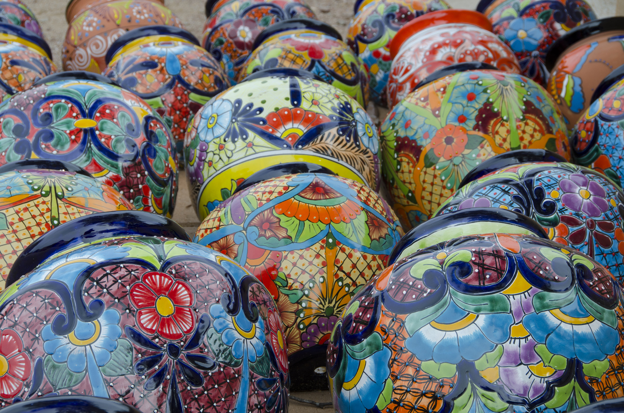 Dozens of brightly painted Mexican flower pots lie on their sides on display in Tubac, Arizona.