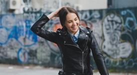 woman in a leather jacket smiling